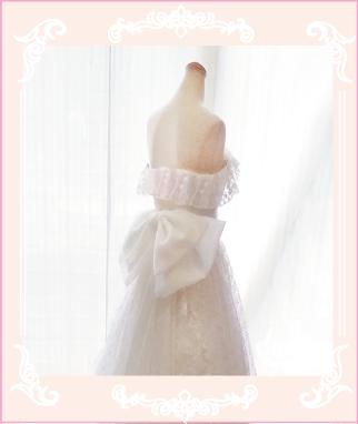 腰の大きいリボン飾りが可愛いウェディングドレスのリメイク例